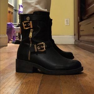 Black leather short boots with gold metal details